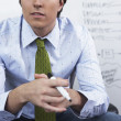 Young businessman looking pensive - Stock Photo