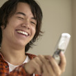Stock Photo: Young man using cell phone