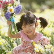 Stock Photo: Portrait of girl with flowers
