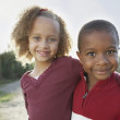 Portrait of two children hugging - Stock Photo