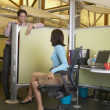 Stok fotoğraf: Business talking over cubicle wall
