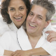 Portrait of couple in robes — Stock Photo