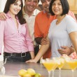 Two middle-aged couples in kitchen — Stock Photo #13234097