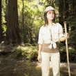 Explorer standing in forested area — Stock Photo