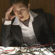 Stock Photo: Businessman puzzling over a nest of wires
