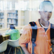 Teenage boy leaving library — Stockfoto