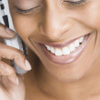 African American woman talking on cell phone — Photo