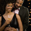 Portrait of African couple with champagne — Stock Photo