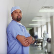 Stock Photo: Mature male surgeon posing