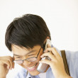 Stock Photo: Businessmtalking on cell phone