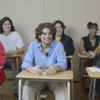 Foto de Stock  : High school students sitting in classroom