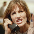 Businesswoman yelling on telephone — Stock Photo