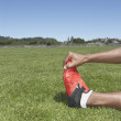 Male track athlete stretching — Stock Photo #13234362
