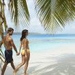 South American couple walking on beach — Stock Photo