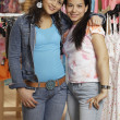 Hispanic teenaged girls shopping for clothing — Stock Photo #13234493