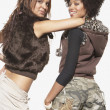 Young women dancing together - Stockfoto