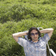 Man relaxing in green meadow — Stock Photo