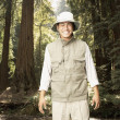 Stock Photo: Explorer smiling in forested area