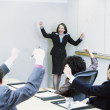 Stock Photo: Businesspeople cheering at meeting