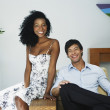 South American couple sitting on chair — Stock Photo