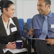 Businesswoman and businessman talking — Stock Photo