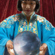Portrait of magician holding crystal ball — Stock Photo