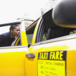 Businesswoman getting into cab — Stock Photo