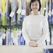 Happy Asian drycleaner  — Stock Photo