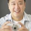 Portrait of man holding camera — Stock Photo
