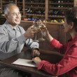 Couple toasting with wine glasses - Stock Photo