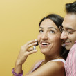 Smiling couple with mobile phone — Stock Photo #13234693