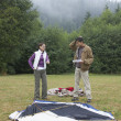 Stock Photo: Indicouple putting up tent