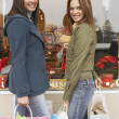 Two young women shopping — Stock Photo #13234721