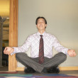 Businessman meditating — Stockfoto