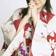Woman in kimono praying — Stock Photo