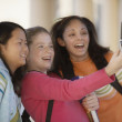 Teenage girls taking picture with cell phone — Stock Photo