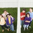 Stock Photo: Mixed Race children on opposite sides of fence
