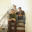 Businessmen sitting on a staircase - Stockfoto