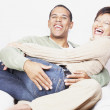 Mholding his girlfriend on his lap — Stock Photo #13234801