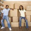 African couple in back of moving truck — Stock Photo
