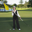 Senior Asian woman on golf course - Zdjęcie stockowe