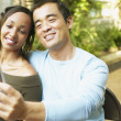 Couple taking self-portrait with cell phone — Stock Photo