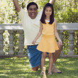 Indian father and daughter playing lawn bowling — Stockfoto