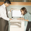 Businesspeople using copy machine — Stock Photo