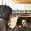 Businessmen in office space — Stock Photo
