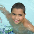 Hispanic boy in swimming pool — Stock Photo