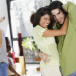 Stock Photo: South American couple dancing at party