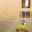 Male construction worker sleeping at construction site — Stock Photo