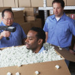 Three male warehouse workers joking around — Stock Photo #13235091