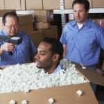 Three male warehouse workers joking around — Stock Photo #13235091